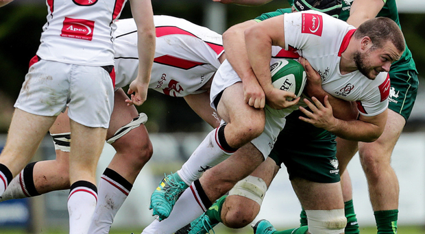 Barging through: Ulster's Peter Cooper is tackled by Joe Maksymiw and Dylan Tierney-Martin of the Connacht Eagles