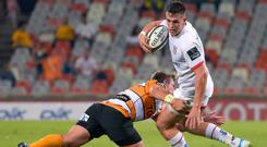 Upbeat: James Hume shrugs off a tackle in a physical battle with Cheetahs