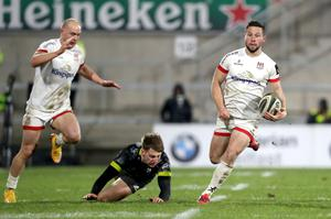 On the run: Ulster's John Cooney goes on a break against Munster