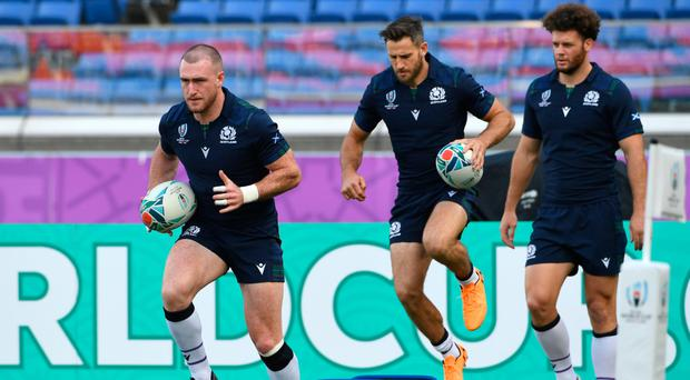 All set: Scotland's Stuart Hogg (left) and his teammates warm up during their training session in Yokohama