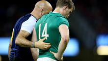 Heartbreak: Andrew Trimble departs last month's match against Wales in Cardiff with the foot injury that hampered his World Cup hopes