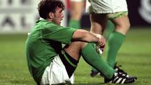 Bad memories: Kieron Dawson shows his dejection after Ireland's defeat by Argentina in the World Cup back in 1999
