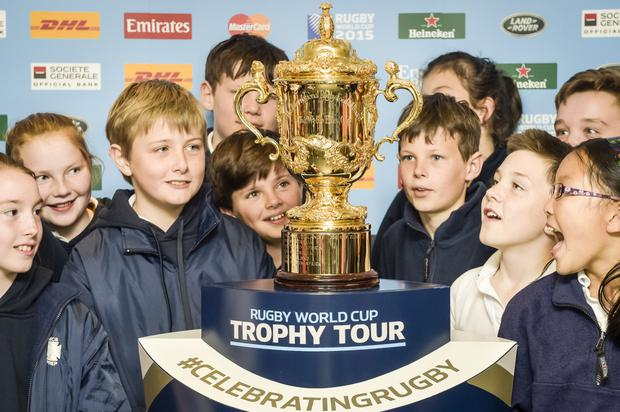 Glittering prize: The Webb Ellis Cup with pupils from Belfast's Downey House School