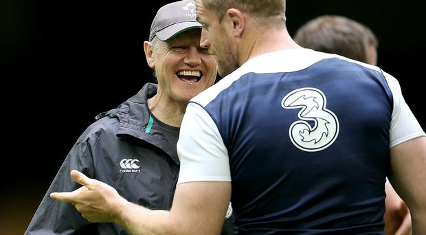 All smiles: Joe Schmidt and Jamie Heaslip in jovial mood