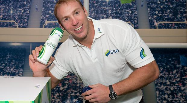 Plenty of bottle: Former Ireland star Stephen Ferris models with the SSE Sounds of Victory bottles