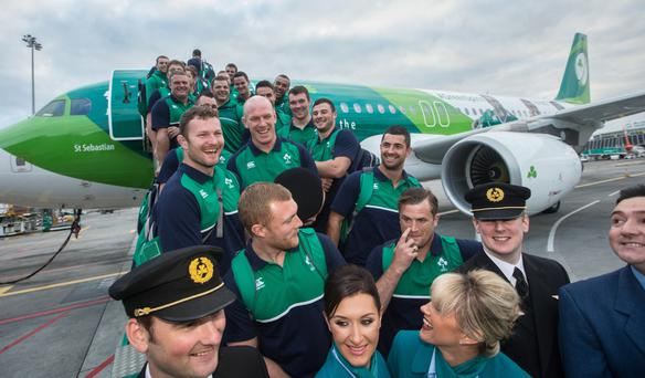 Flying high: the Ireland rugby team board the Aer Lingus Green Spirit plane at Dublin Airport yesterday ahead of Saturday's clash with Canada in Cardiff