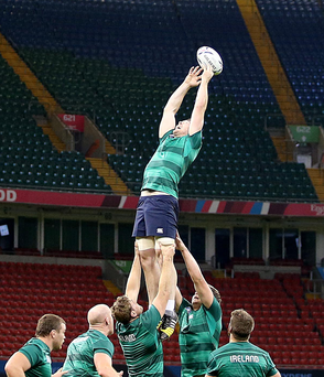 Aiming high: Peter O'Mahony tries to get hold of the ball during Ireland's Captain's Run at the Millennium Stadium