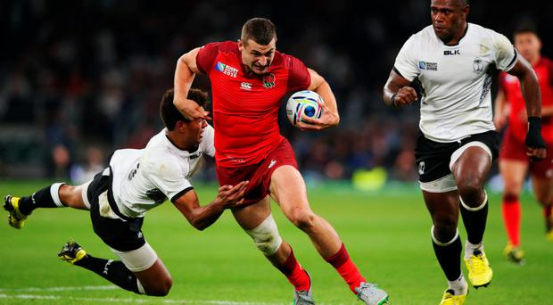 Charging on: Jonny May of England evades a tackle from Ben Volavola of Fiji during the Rugby World Cup Pool A opener