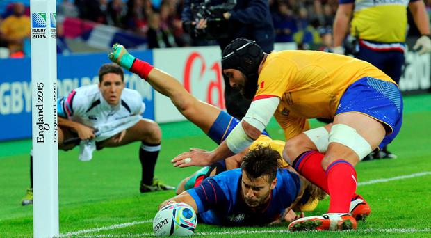 Reaching out: France's Sofiane Guitoune dives past Romania's Danut Dumbrava to score his side's first try