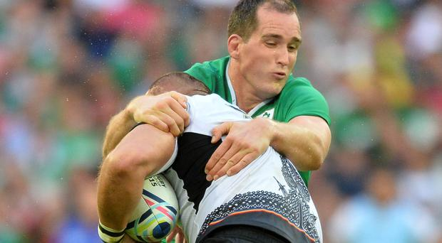Holding on: Devin Toner took his chance against Romania