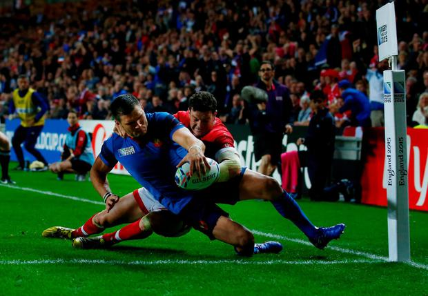 Brute strength: France's Remy Grosso powers over the try line
