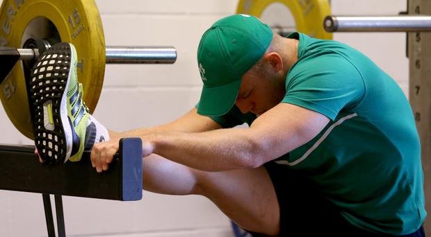 At a stretch: Ian Madigan limbers up in training ahead of the crunch clash against France this weekend
