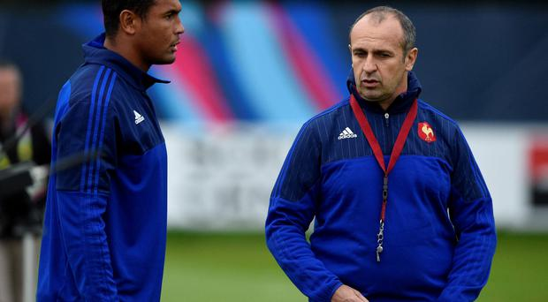 Still a team: France's head coach Philippe Saint-Andre (right) speaks with France's captain Thierry Dusautoir in training