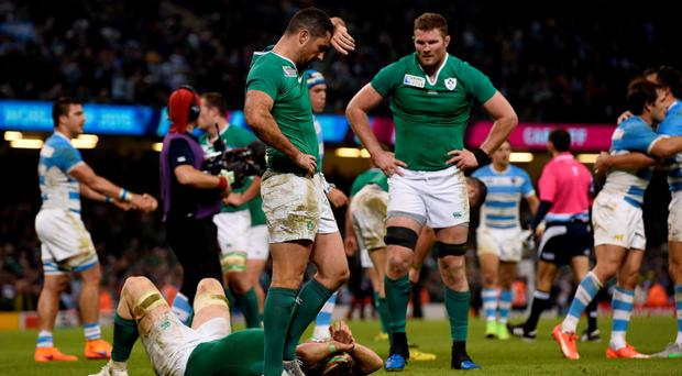 Down and out: Rob Kearney and his Ireland team-mates show their dejection after last week's defeat by Argentina