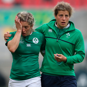 Pain game: A dejected Alison Miller is comforted after defeat