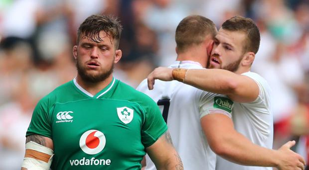 Mauled: Ireland's Andrew Porter shows his disappointment as England celebrate