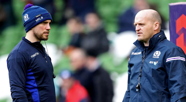 Clever heads: Mike Blair (left) and Gregor Townsend have made Scotland's players train with rugby balls covered in shampoo and water to mimic the wet conditions they could face