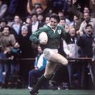 On the run: Gordon Hamilton leaves David Campese in his wake to score at Lansdowne Road