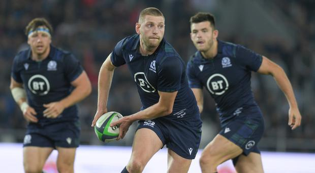 Upbeat: Finn Russell is sure Scotland will hit the heights