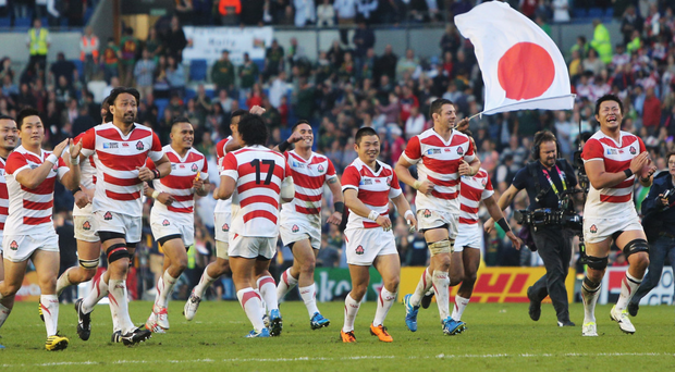 Famous night: Japan enjoy their stunning win over South Africa at the 2015 World Cup