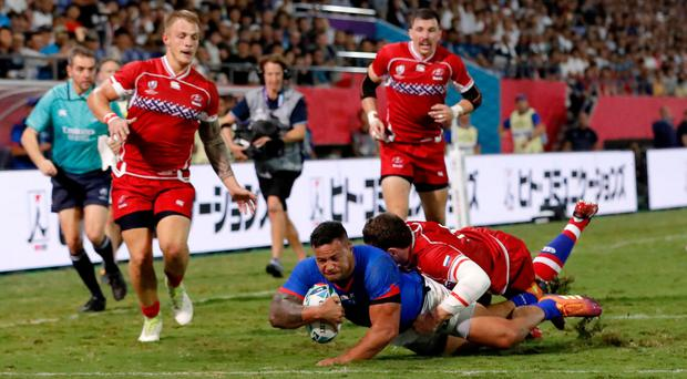 Touchdown: AJ Alatimu of Samoa scores his side's first try during the game against Russia at Kumagaya Rugby Stadium