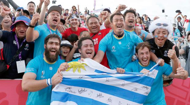 Proud day: Uruguay's players celebrate with the crowd
