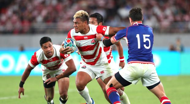 Surging on: Lomano Lemeki of Japan makes a break during the hosts' win over Russia