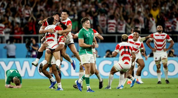 Joy and pain: Jacob Stockdale is dejected as Japan celebrate their victory