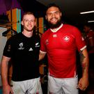 Reunited: Former Royal School Dungannon pupil Peter Nelson (left), now of Canada, and Angus Ta'avao of New Zealand, who coached at the school, pose for a photo after yesterday's game