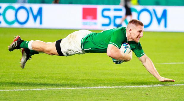 Flat out: Andrew Conway scores Ireland's fourth try against Russia in Kobe yesterday to secure the bonus point