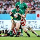 Taken down: Cian Healy finds no way through during the loss to Japan
