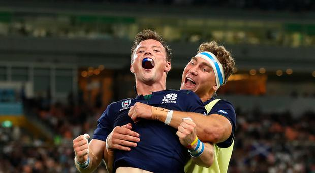 Unstoppable: George Horne of Scotland celebrates his try with Jamie Ritchie
