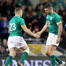 Shake on it: Rob Kearney is replaced by Jordan Larmour during Ireland's clash with New Zealand last year