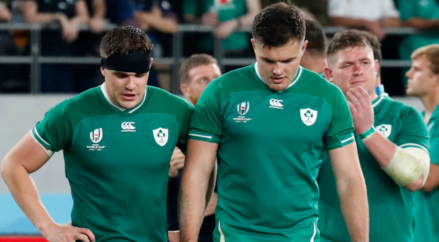 Game over: Jacob Stockdale leads a disconsolate Ireland off after losing to the All Blacks