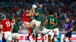 A step above: Lood de Jager of South Africa in action during the semi-final against Wales