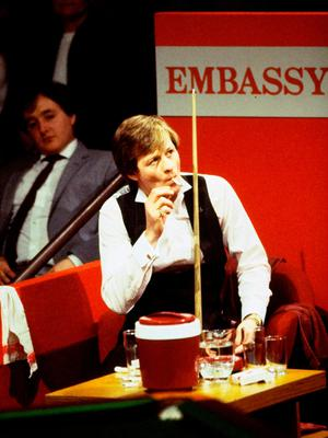 Alex Higgins relaxes during the World Snooker Championships in 1983.