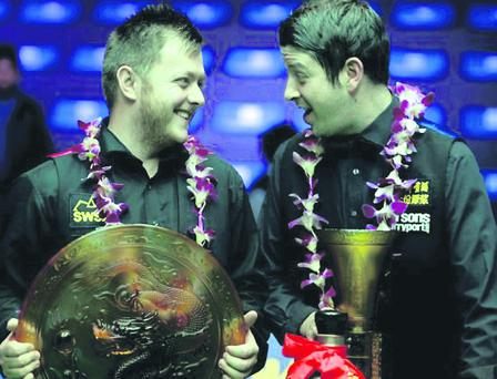 Mark Allen (left) after beating Matthew Stevens in yesterday's World Open final in China
