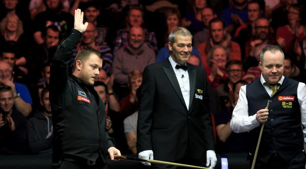 Worth wait: Mark Allen waves to the crowd after escaping a snooker following three attempts as John Higgins (right) looks on