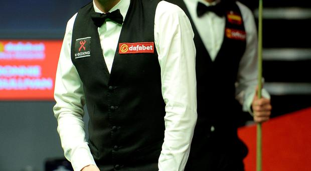 I'm behind you: Mark Selby on the way to victory over Ronnie O'Sullivan in last year's final at the Crucible in Sheffield