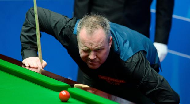 Winner: John Higgins on way to victory at the Crucible