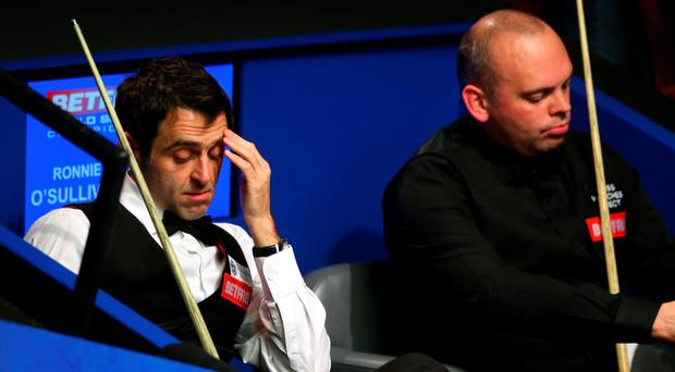 Ronnie O'Sullivan was beaten 13-9 by Stuart Bingham in the quarter-finals of the World Championship at The Crucible