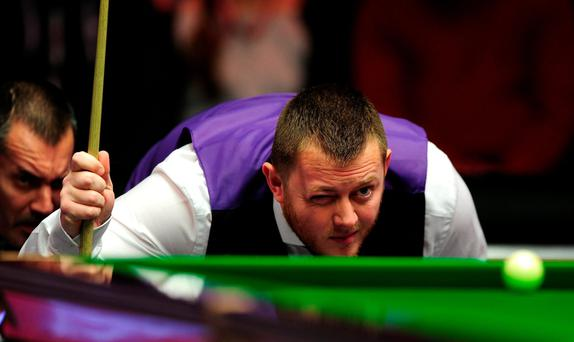 Clear aim: Mark Allen lines up a shot on way to victory over Shaun Murphy at the Masters