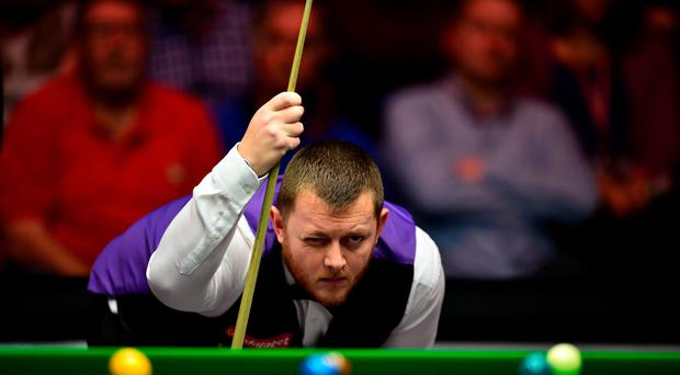 Off target: Mark Allen weighs up his options during the 6-2 Masters quarter-final defeat against Barry Hawkins