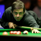 Focused: Ronnie O'Sullivan beats Jimmy White last night