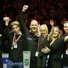 Just champion: Mark King celebrates with his family after winning the Northern Ireland Open, his first ranking event title, at the Titanic Exhibition Centre and (below) Lauren Higgins, daughter of Alex, watches on