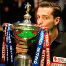 Top of world: Mark Selby after last night's World title triumph