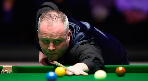 On cue: John Higgins on his way to victory last night
