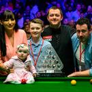Proud fans: Mark Allen celebrates with family including wife Kyla after winning the 2018 Dafabet Masters at Alexandra Palace