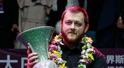 China vase: Mark Allen with the International Snooker Championship trophy in Daqing