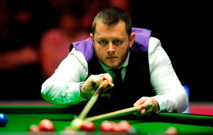On cue: Mark Allen on his way to victory over Shaun Murphy yesterday at Alexandra Palace
